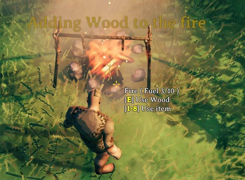 adding wood to the campfire
